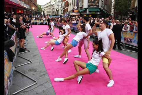 Dancers on the pink carpet